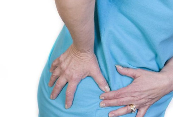 Распространения болевого синдрома на область тазобедренного сустава.