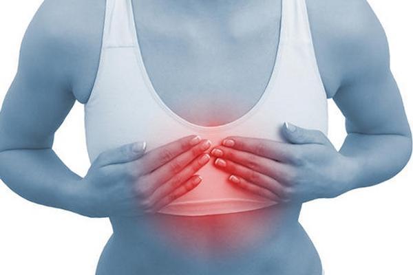 Боль, покалывание, ощущение тяжести в области молочных желез