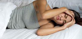 По каким причинам болит голова во время месячных